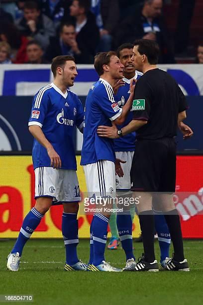 Marco Hoeger Benedikt Hoewedes and Joel Matip of Schalke shout at referee Manuel Graefe after the first goal of Leverkusen during the Bundesliga...