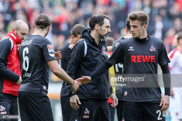 Marco Hoeger of Colonge and Lukas Kluenter of Colonge looks dejected during the Bundesliga match between FC Augsburg and 1 FC Koeln at WWK Arena on...