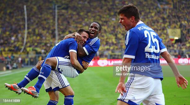 Marco Hoeger of Schalke celebrates his team's second goal with team mates Jefferson Farfan and KlaasJan Huntelaar during the Bundesliga match between...