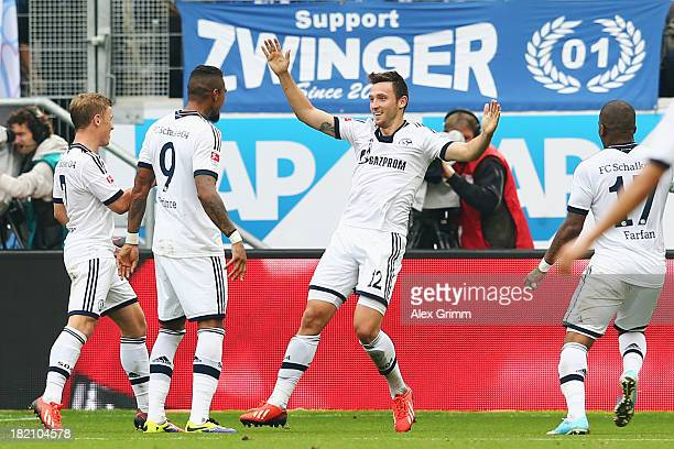 Marco Hoeger of Schalke celebrates his team's third goal with team mates Max Meyer KevinPrince Boateng and Jefferson Farfan during the Bundesliga...