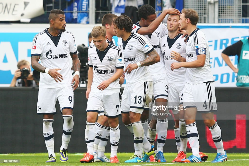 <a gi-track='captionPersonalityLinkClicked' href=/galleries/search?phrase=Marco+Hoeger&family=editorial&specificpeople=6872414 ng-click='$event.stopPropagation()'>Marco Hoeger</a> (2R) of Schalke celebrates his team's third goal with team mates during the Bundesliga match between 1899 Hoffenheim and FC Schalke 04 on September 28, 2013 in Sinsheim, Germany.