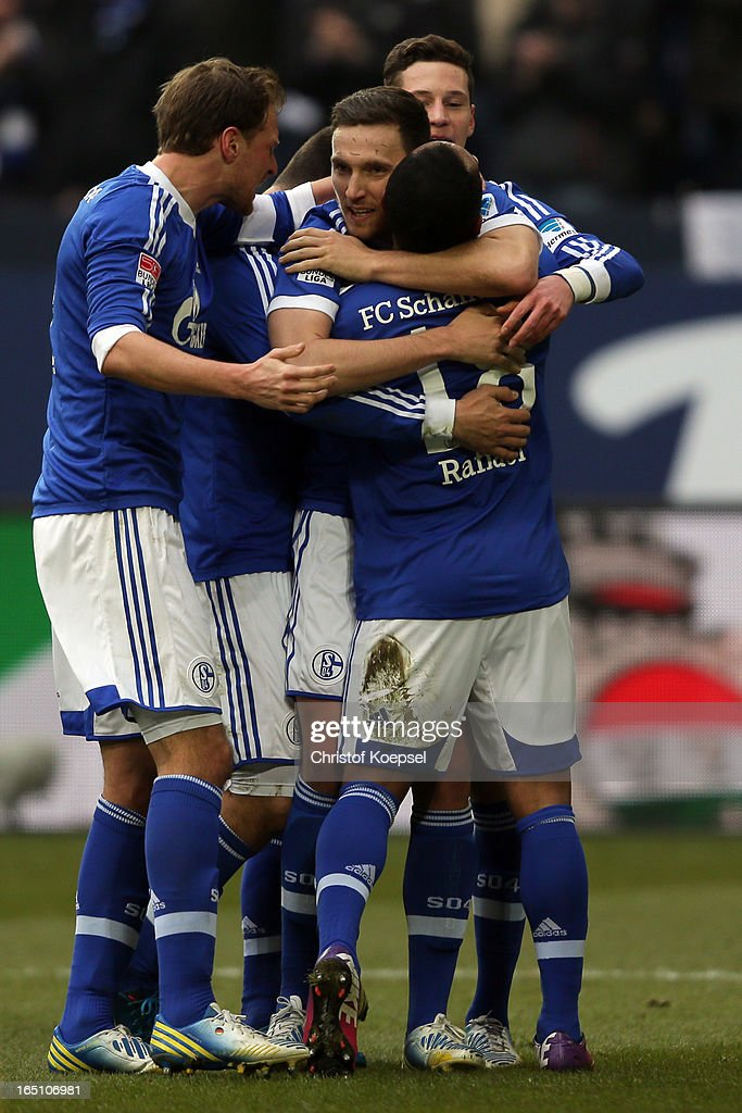 Marco Hoeger of Schalke (C) celebrates the first goal with Benedikt Hoewedes (L), Raffael (2nd R) and <a gi-track='captionPersonalityLinkClicked' href=/galleries/search?phrase=Julian+Draxler&family=editorial&specificpeople=7184479 ng-click='$event.stopPropagation()'>Julian Draxler</a> of Schalke (R) during the Bundesliga match between FC Schalke 04 and TSG 1899 Hoffenheim at Veltins-Arena on March 30, 2013 in Gelsenkirchen, Germany.