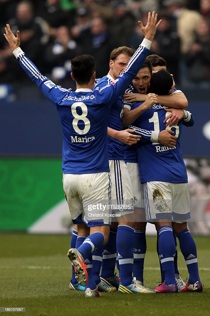 Marco Hoeger of Schalke (C) celebrates the first goal with <a gi-track='captionPersonalityLinkClicked' href=/galleries/search?phrase=Ciprian+Marica&family=editorial&specificpeople=2178476 ng-click='$event.stopPropagation()'>Ciprian Marica</a> (L), Benedikt Hoewedes and Raffael (R) during the Bundesliga match between FC Schalke 04 and TSG 1899 Hoffenheim at Veltins-Arena on March 30, 2013 in Gelsenkirchen, Germany.