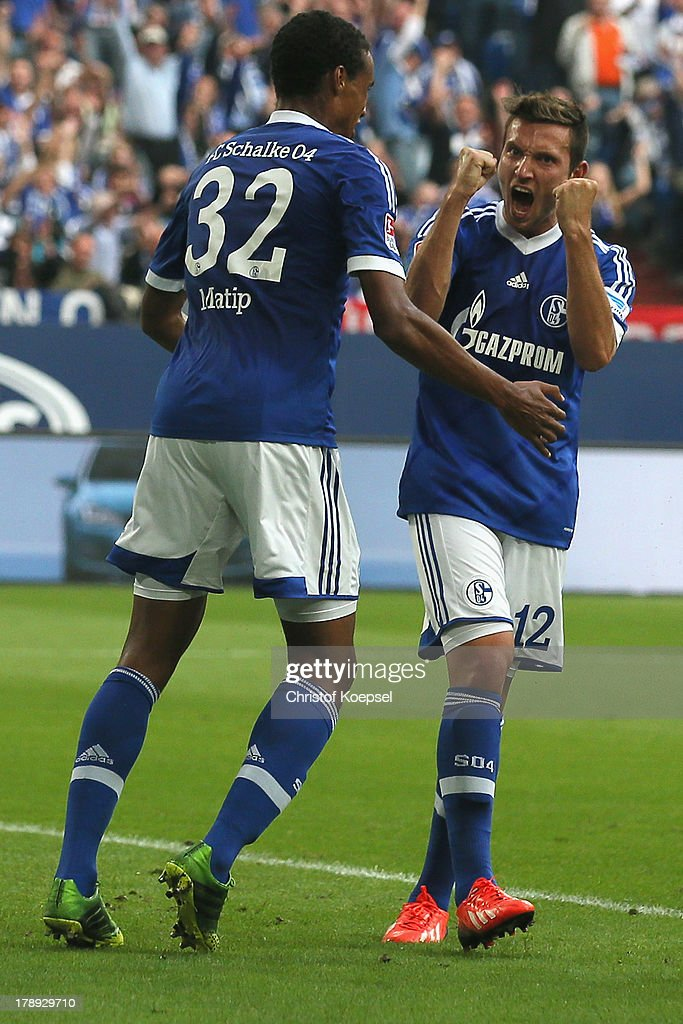 <a gi-track='captionPersonalityLinkClicked' href=/galleries/search?phrase=Marco+Hoeger&family=editorial&specificpeople=6872414 ng-click='$event.stopPropagation()'>Marco Hoeger</a> of Schalke (R) celebrates the first goal with <a gi-track='captionPersonalityLinkClicked' href=/galleries/search?phrase=Joel+Matip&family=editorial&specificpeople=4462851 ng-click='$event.stopPropagation()'>Joel Matip</a> (L) during the Bundesliga match between FC Schalke 04 and Bayer Leverkusen at Veltins-Arena on August 31, 2013 in Gelsenkirchen, Germany.