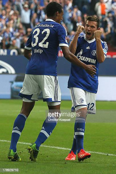Marco Hoeger of Schalke celebrates the first goal with Joel Matip during the Bundesliga match between FC Schalke 04 and Bayer Leverkusen at...