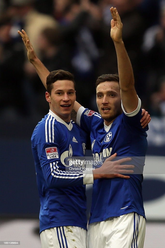 Marco Hoeger of Schalke (R) celebrates the first goal with <a gi-track='captionPersonalityLinkClicked' href=/galleries/search?phrase=Julian+Draxler&family=editorial&specificpeople=7184479 ng-click='$event.stopPropagation()'>Julian Draxler</a> of Schalke (L) during the Bundesliga match between FC Schalke 04 and TSG 1899 Hoffenheim at Veltins-Arena on March 30, 2013 in Gelsenkirchen, Germany.