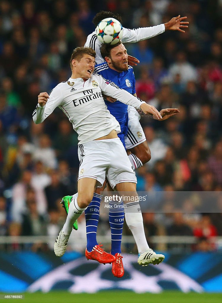 Marco Hoeger of Schalke jumps between Raphael Varane (top) and <a gi-track='captionPersonalityLinkClicked' href=/galleries/search?phrase=Toni+Kroos&family=editorial&specificpeople=638597 ng-click='$event.stopPropagation()'>Toni Kroos</a> of Real Madrid CF (front) during the UEFA Champions League Round of 16 second leg match between Real Madrid CF and FC Schalke 04 at Estadio Bernabeu on March 10, 2015 in Madrid, Spain.