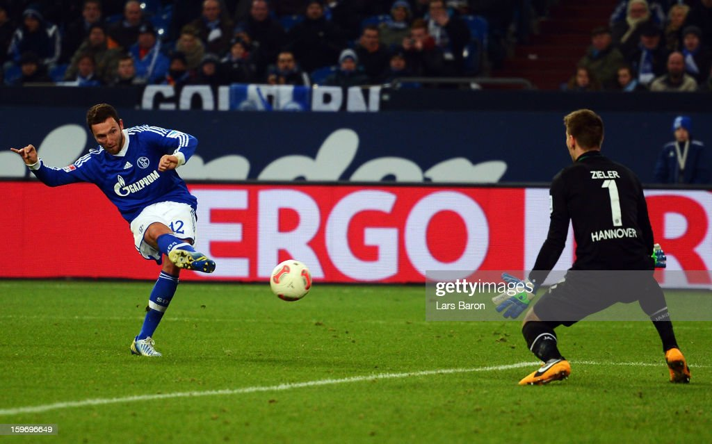 <a gi-track='captionPersonalityLinkClicked' href=/galleries/search?phrase=Marco+Hoeger&family=editorial&specificpeople=6872414 ng-click='$event.stopPropagation()'>Marco Hoeger</a> of Schalke scores his teams third goal during the Bundesliga match between FC Schalke 04 and Hannover 96 at Veltins-Arena on January 18, 2013 in Gelsenkirchen, Germany.