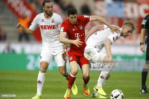 Marco Hoger of 1FC Koln Robert Lewandowski of Bayern Munich Frederik Sorensen of 1FC Kolnduring the Bundesliga match between 1 FC Koln and Bayern...