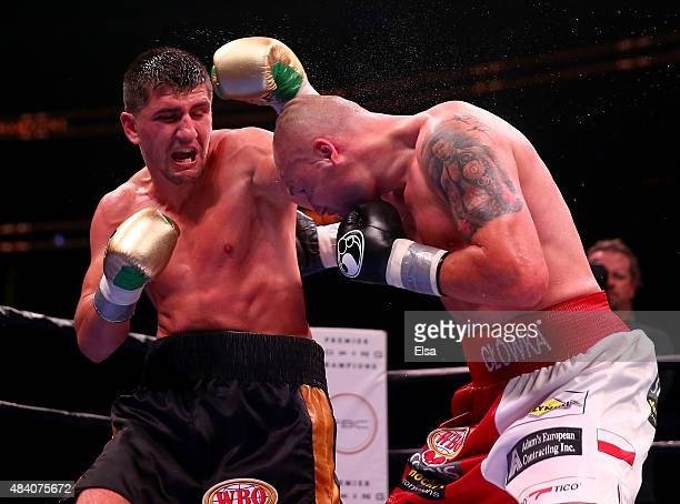 Marco Huck and Krzysztof Glowacki exchange punches during the Premier Boxing Champions Cruiserweight bout at the Prudential Center on August 14 2015...