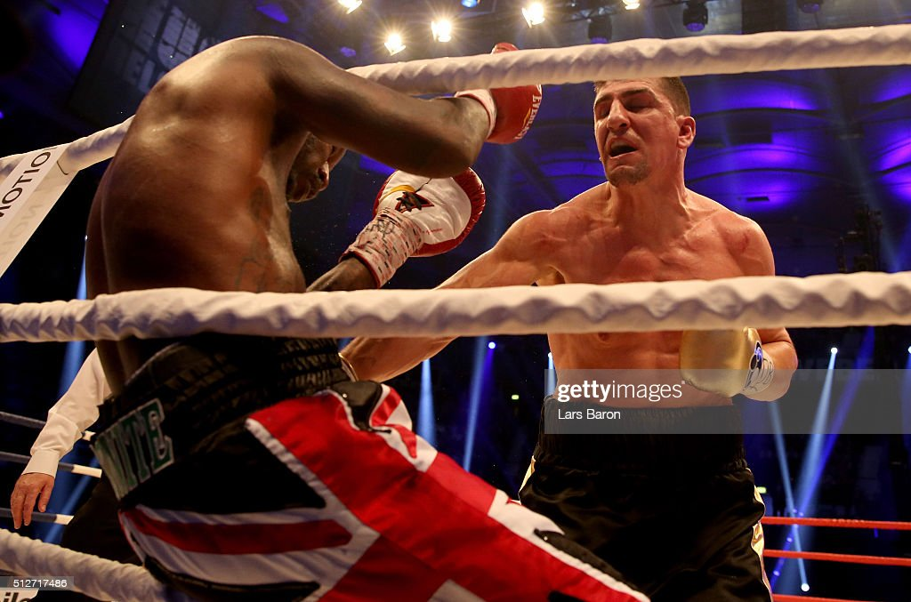 Marco Huck and Ola Afolabi in action during the IBO Cruiserweight World Championship fight between Marco Huck and Ola Afolabi at Gerry Weber Stadium on February 27, 2016 in Halle, Germany.