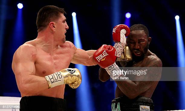 Marco Huck and Ola Afolabi in action during the IBO Cruiserweight World Championship fight between Marco Huck and Ola Afolabi at Gerry Weber Stadium...