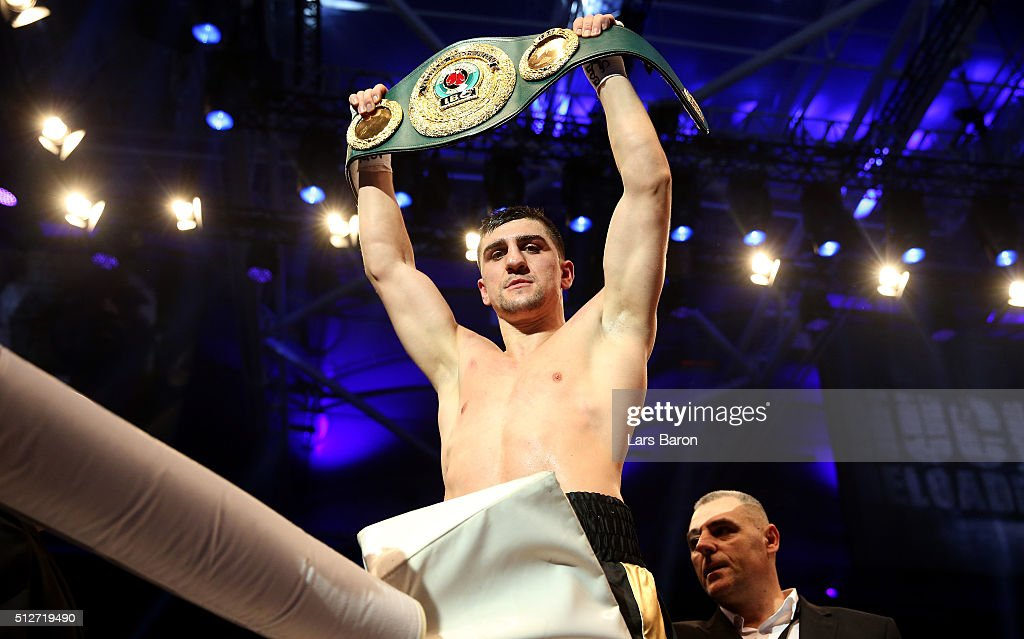 Marco Huck celebrates after winning the IBO Cruiserweight World Championship fight between Marco Huck and Ola Afolabi at Gerry Weber Stadium on February 27, 2016 in Halle, Germany.