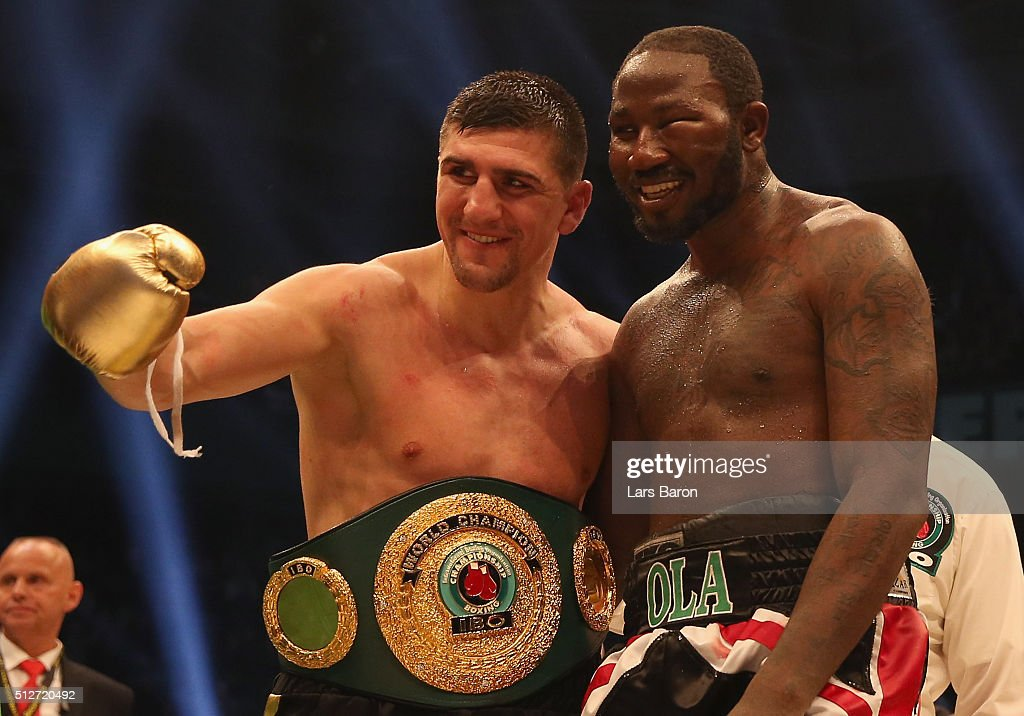 Marco Huck hughs Ola Afolabi after winning the IBO Cruiserweight World Championship fight between Marco Huck and Ola Afolabi at Gerry Weber Stadium on February 27, 2016 in Halle, Germany.
