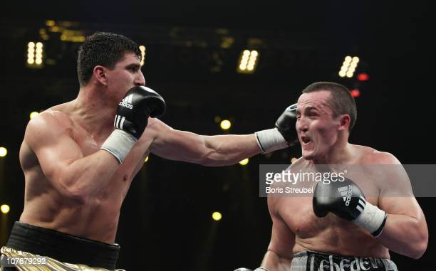 Marco Huck of Germany and Denis Lebedev of Russia exchange punches during their WBO World Championship Cruiserweight title fight at MaxSchmeling Hall...