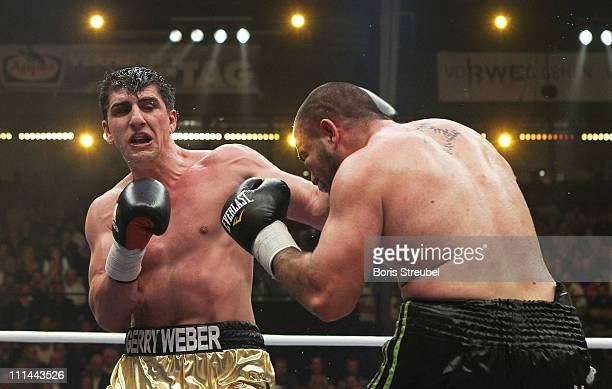 Marco Huck of Germany and Ran Nakash of Israel exchange punches during their WBO World Championship Cruiserweight title fight at Gerry Weber Stadion...