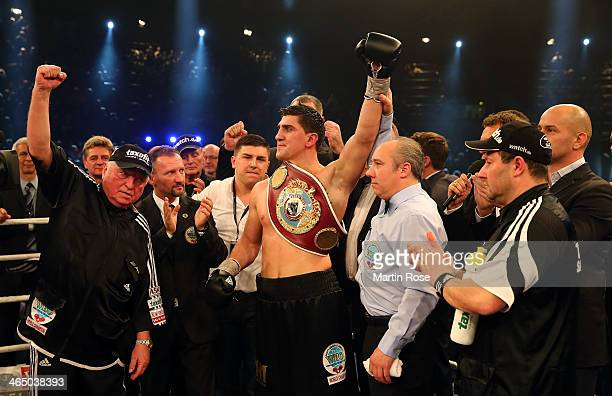 Marco Huck of Germany celebrate with coach Ulli Wegner after winning the WBO Cruiserweight title fight over Firat Arslan of Germany at...