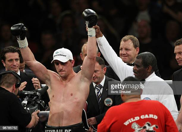 Marco Huck of Germany celebrates after winning the WBO World Championship Cruiserweight title fight against Brian Minto at the WeserEmsHalle on May 1...