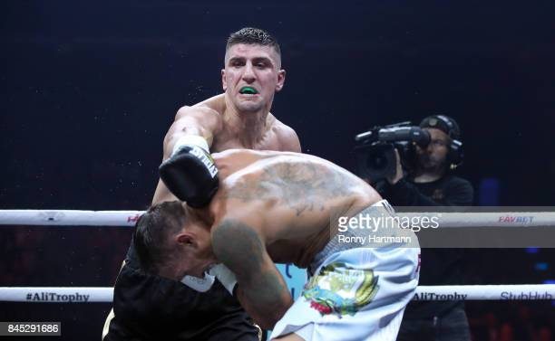 Marco Huck of Germany punches Aleksandr Usyk of Ukraine during the WBO Cruiserweight World Boxing Super Series fight at Max Schmeling Halle on...