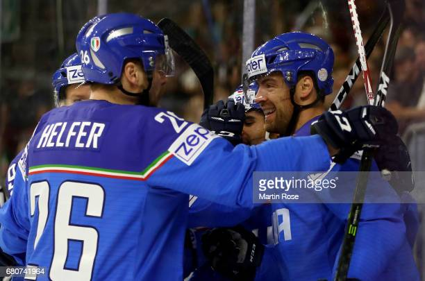Marco Insam of Italy celebrate with his team mates after he scores the opening goal during the 2017 IIHF Ice Hockey World Championship game between...