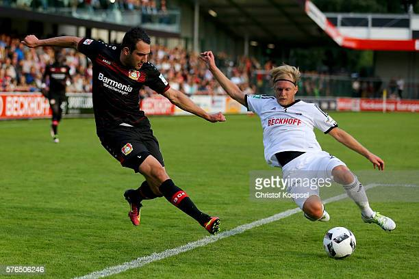 Marco Kaminski of Verl defends against Levin Oeztunali of Leverkusen during the friendly match between SC Verl and Bayer Leverkusen at Sportclub...