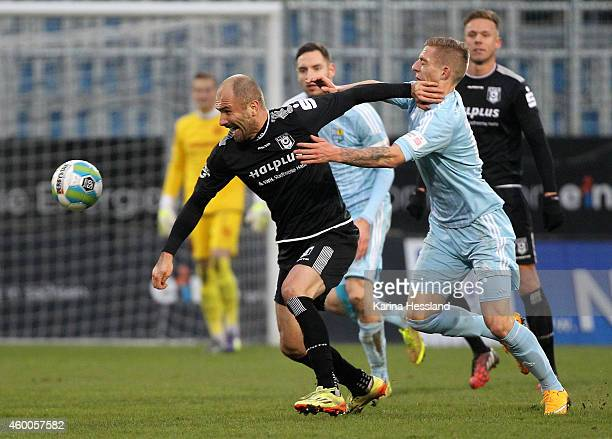Marco KehlGomez of Chemnitz challenges Ivica Banovic of Halle during the 3Liga match between Chemnitzer FC and Hallescher FC at Stadion an der...