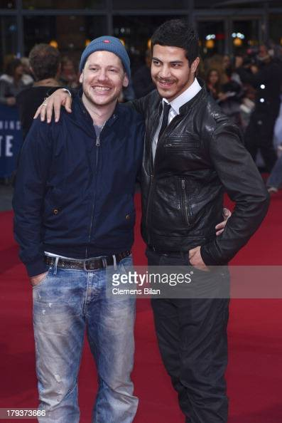 Marco Kreuzpaintner and his husband Gilardi attend the 'White House Down' Germany premiere at CineStar on September 2 2013 in Berlin Germany