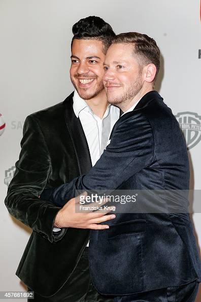 Marco Kreuzpaintner and his husband Gilardo attend the 'Coming In' Premiere in Berlin on October 22 2014 in Berlin Germany
