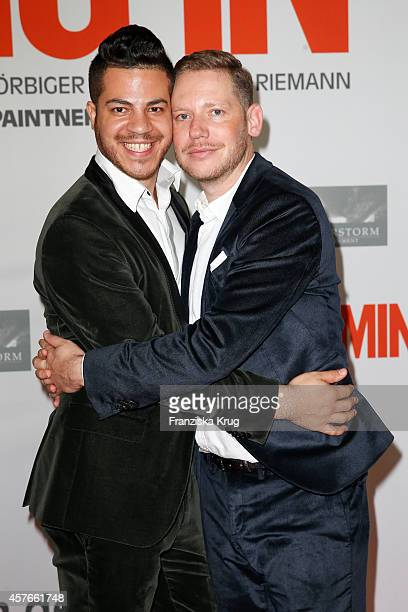 Marco Kreuzpaintner and his husband Gilardo attend the 'Coming In' Premiere in Berlin on October 22 2014 in Berlin Germany
