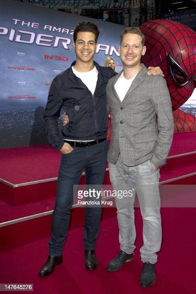 'BERLIN GERMANY JUNE 20 Marco Kreuzpaintner and his man Gilardi attend the Germany premiere of ''The Amazing SpiderMan'' at Sony Center on June 20...