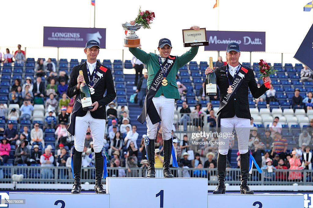 Marco Kutscher of Germany, Abdullah Alsharbatly of Saudi Arabia celebrating the first position with his trophy and <a gi-track='captionPersonalityLinkClicked' href=/galleries/search?phrase=Marc+Houtzager&family=editorial&specificpeople=5500270 ng-click='$event.stopPropagation()'>Marc Houtzager</a> of Nederlands during the Longines Global Champions Tour of Shanghai jump-off 1.60 m height on April 30, 2016 in Shanghai, China.