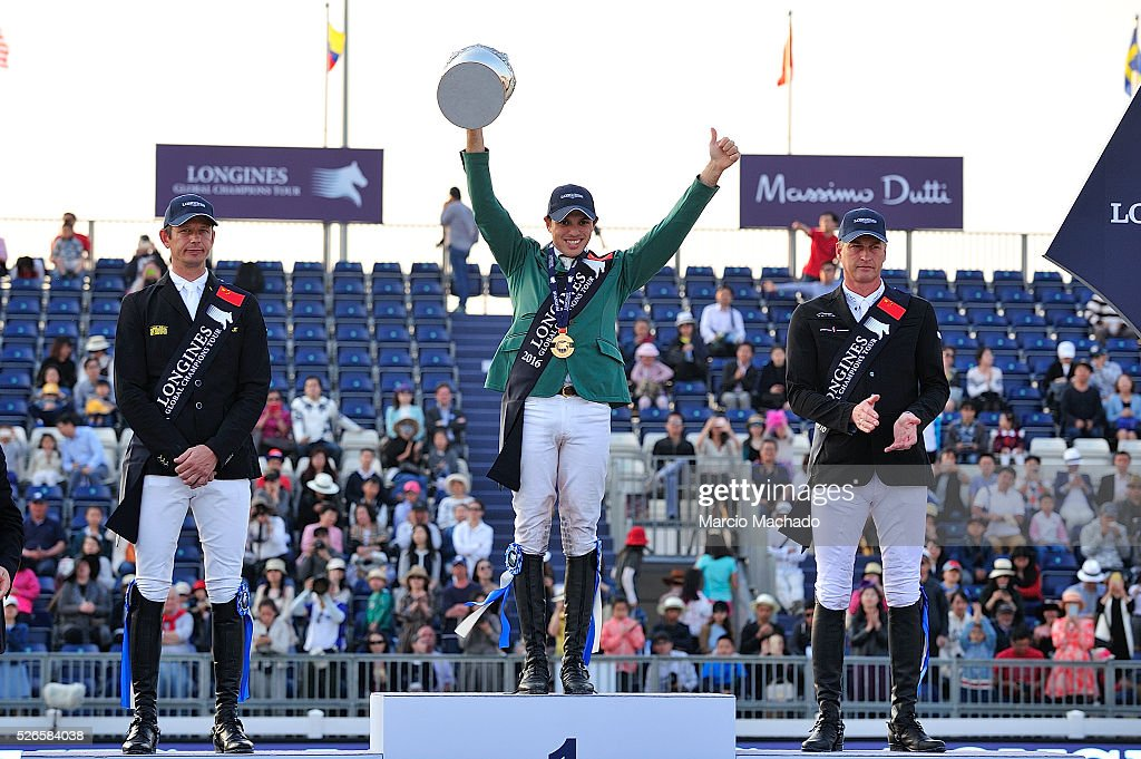 Marco Kutscher of Germany, Abdullah Alsharbatly of Saudi Arabia celebrating the first position with his trophy and Marc Houtzager of Nederlands during the Longines Global Champions Tour of Shanghai jump-off 1.60 m height on April 30, 2016 in Shanghai, China.