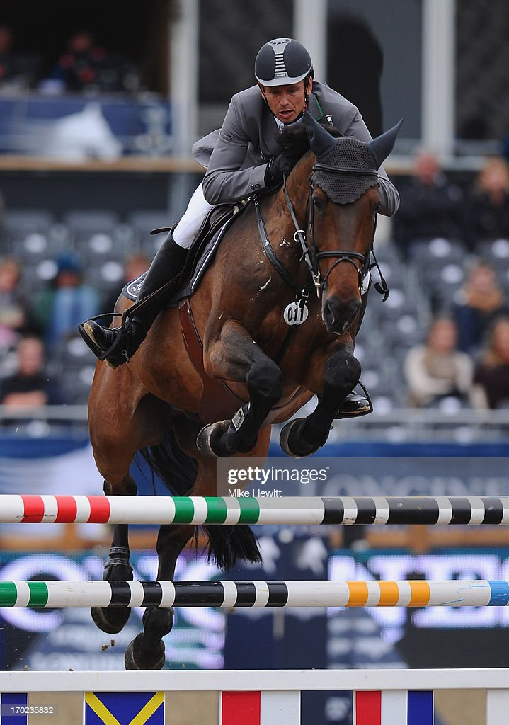 <a gi-track='captionPersonalityLinkClicked' href=/galleries/search?phrase=Marco+Kutscher&family=editorial&specificpeople=2272349 ng-click='$event.stopPropagation()'>Marco Kutscher</a> of Germany on Cash on thier way to victory during the Longines Global Champions Tour of London on Day Four at Olympic Park on June 9, 2013 in London, England.