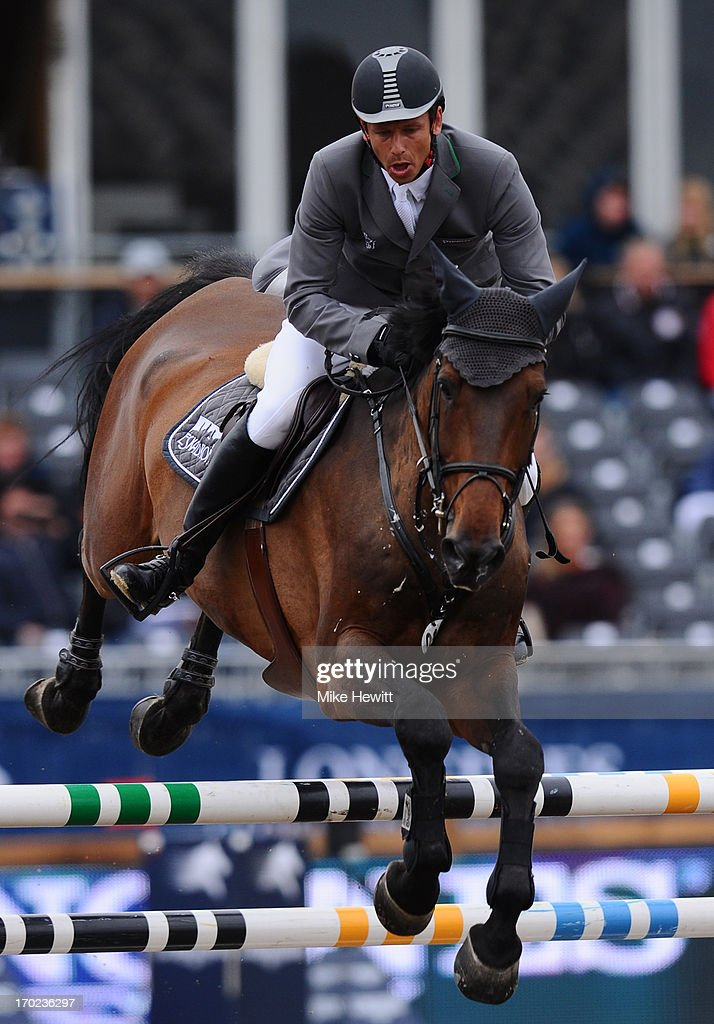 <a gi-track='captionPersonalityLinkClicked' href=/galleries/search?phrase=Marco+Kutscher&family=editorial&specificpeople=2272349 ng-click='$event.stopPropagation()'>Marco Kutscher</a> of Germany on Cash on their way to victory during the Longines Global Champions Tour of London on Day Four at Olympic Park on June 9, 2013 in London, England.