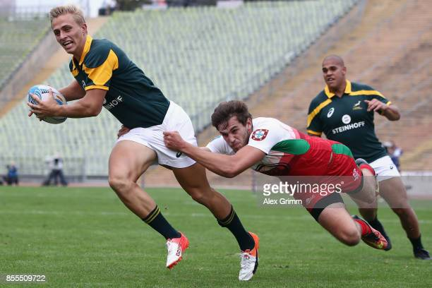 Marco Labuschagne of South Africa scores a try under pressure from Gabriel Pop of Portugal during the match between South Africa and Portugal on Day...