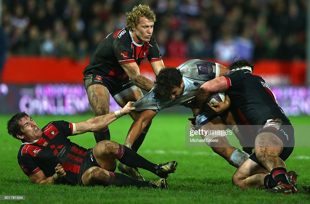 Marco Mama (2R) of Worcester is tackled by Dan Murphy (R), Billy Twelvetrees (2L) and James Hook (L) of Gloucester during the European Rugby Challenge Cup Round Four match between Gloucester Rugby and Worcester Warriors at Kingsholm Stadium on December 17, 2015 in Gloucester, England.