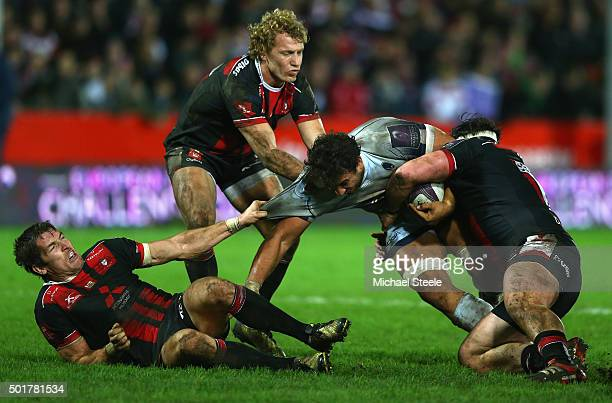 Marco Mama of Worcester is tackled by Dan Murphy Billy Twelvetrees and James Hook of Gloucester during the European Rugby Challenge Cup Round Four...