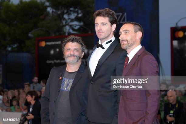 Marco Manetti Giampaolo Morelli and Antonio Manetti walk the red carpet ahead of the 'Ammore E Malavita' screening during the 74th Venice Film...
