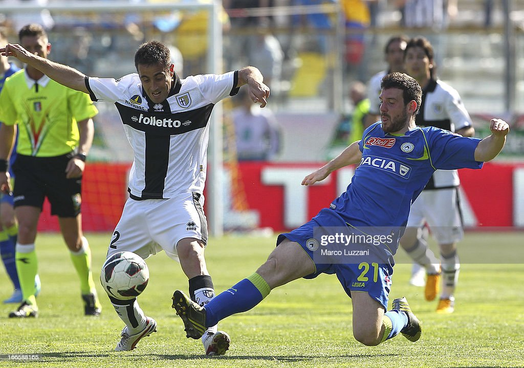 <a gi-track='captionPersonalityLinkClicked' href=/galleries/search?phrase=Marco+Marchionni&family=editorial&specificpeople=615713 ng-click='$event.stopPropagation()'>Marco Marchionni</a> of Parma FC competes for the ball with Andrea Lazzari of Udinese Calcio during the Serie A match between Parma FC and Udinese Calcio at Stadio Ennio Tardini on April 14, 2013 in Parma, Italy.