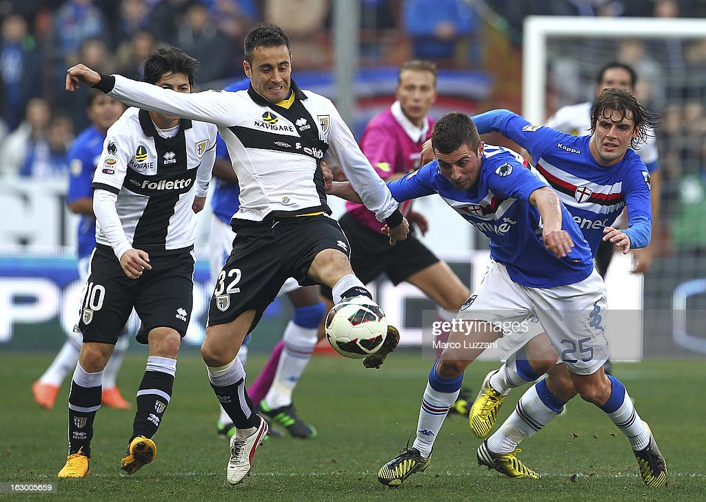 Marco Marchionni of Parma FC competes for the ball with Nenad Krsticic of UC Sampdoria during the Serie A match between UC Sampdoria and Parma FC at Stadio Luigi Ferraris on March 3, 2013 in Genoa, Italy.