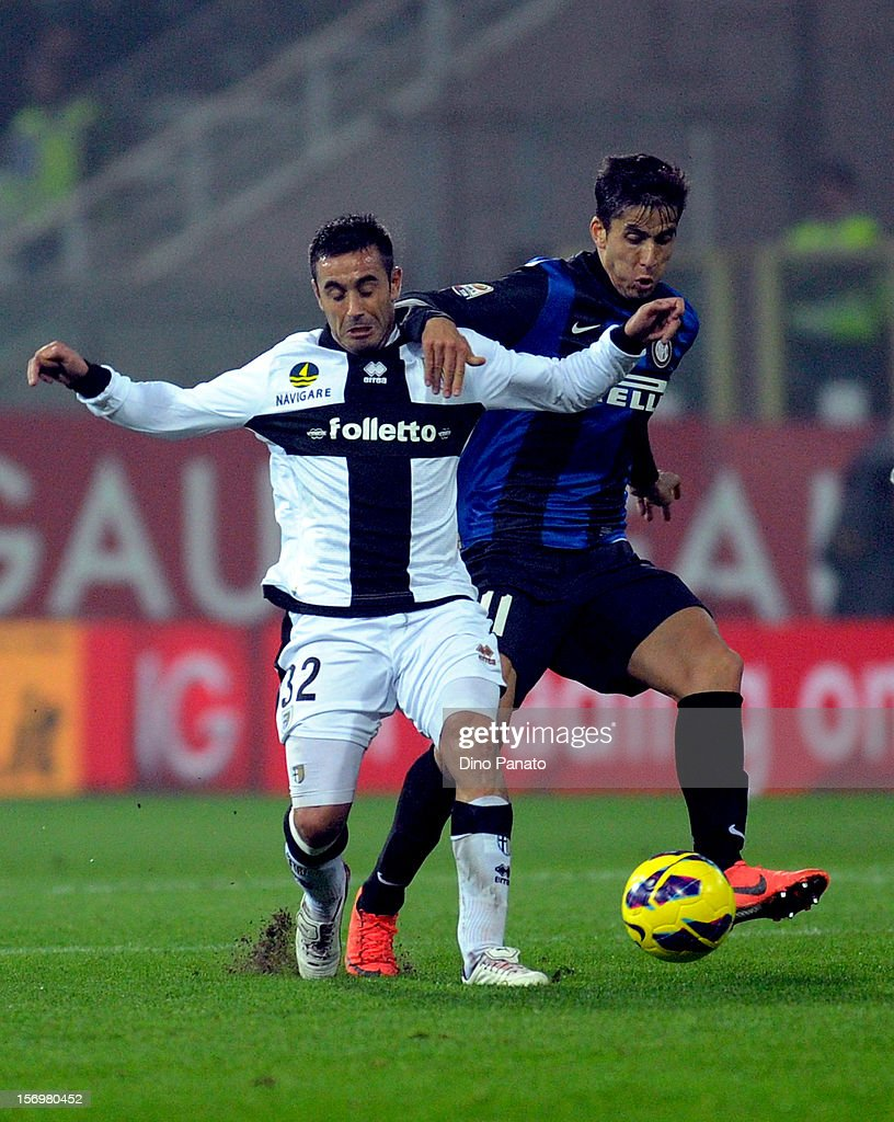 Marco Marchionni (L) of Parma FC competes with Ricardo Alvarez of Internazionale Milano during the Serie A match between Parma FC and FC Internazionale Milano at Stadio Ennio Tardini on November 26, 2012 in Parma, Italy.