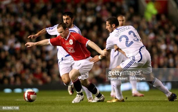 Marco Materazzi and Gennaro Gattuso and Manchester United's Wayne Rooney battle for the ball
