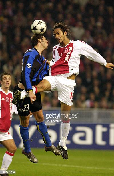 Marco Materazzi of Inter Milan battles with Mido of Ajax during the UEFA Champions League First Phase Group D match between Ajax and Inter Milan on...