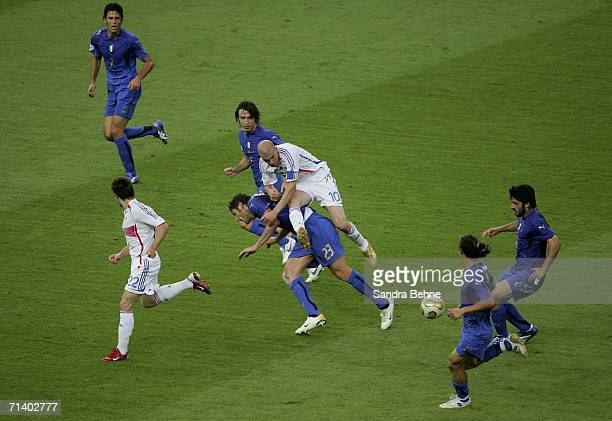 Marco Materazzi of Italy is knocked to the ground by Zinedine Zidane of France whilst challenging for the ball during the FIFA World Cup Germany 2006...