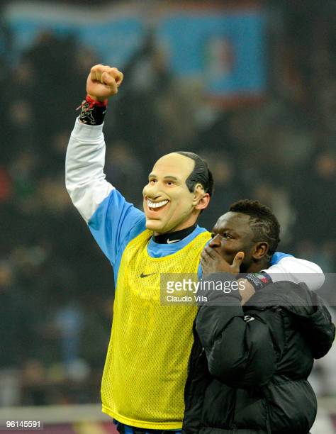Marco Materazzi wearing a mask and Sulley Muntari of FC Internazionale Milano celebrate after winning the Serie A match between Inter Milan and AC...