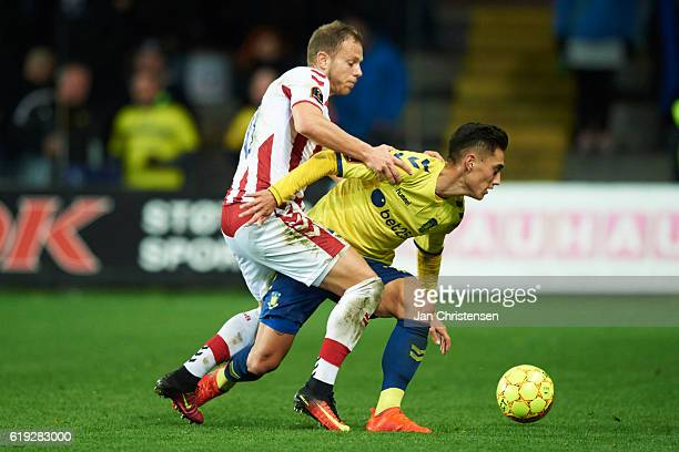 Marco Meilinger of AaB Aalborg and Svenn Crone of Brondby IF compete for the ball during the Danish Alka Superliga match between Brondby IF and AaB...