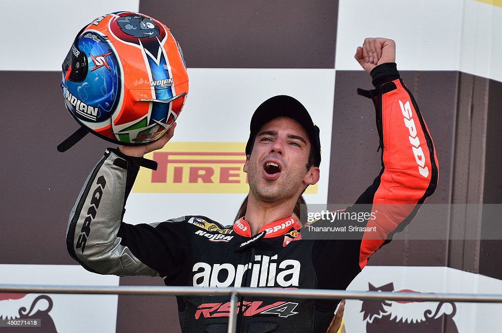 <a gi-track='captionPersonalityLinkClicked' href=/galleries/search?phrase=Marco+Melandri&family=editorial&specificpeople=204382 ng-click='$event.stopPropagation()'>Marco Melandri</a> celebrates during the second race of round six FIM Superbike World Championship at Sepang Circuit on June 8, 2014 in Kuala Lumpur, Malaysia.