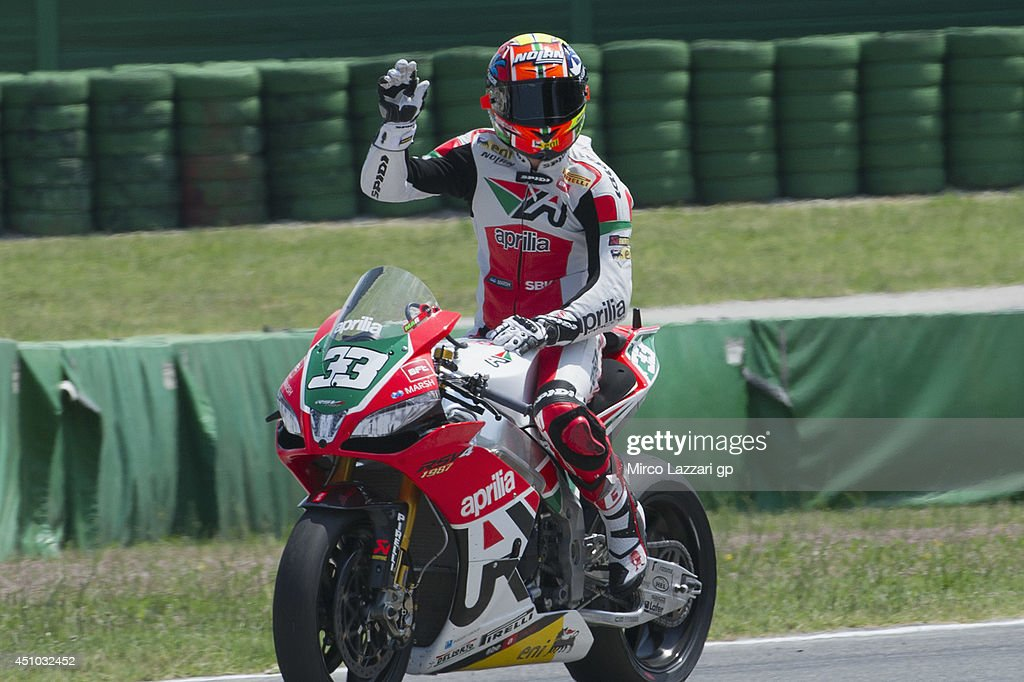 <a gi-track='captionPersonalityLinkClicked' href=/galleries/search?phrase=Marco+Melandri&family=editorial&specificpeople=204382 ng-click='$event.stopPropagation()'>Marco Melandri</a> of Italy and Aprilia Racing Team celebrates the third place at the end of the Superbike race 1 during the FIM Superbike World Championship - Race at Misano World Circuit on June 22, 2014 in Misano Adriatico, Italy.