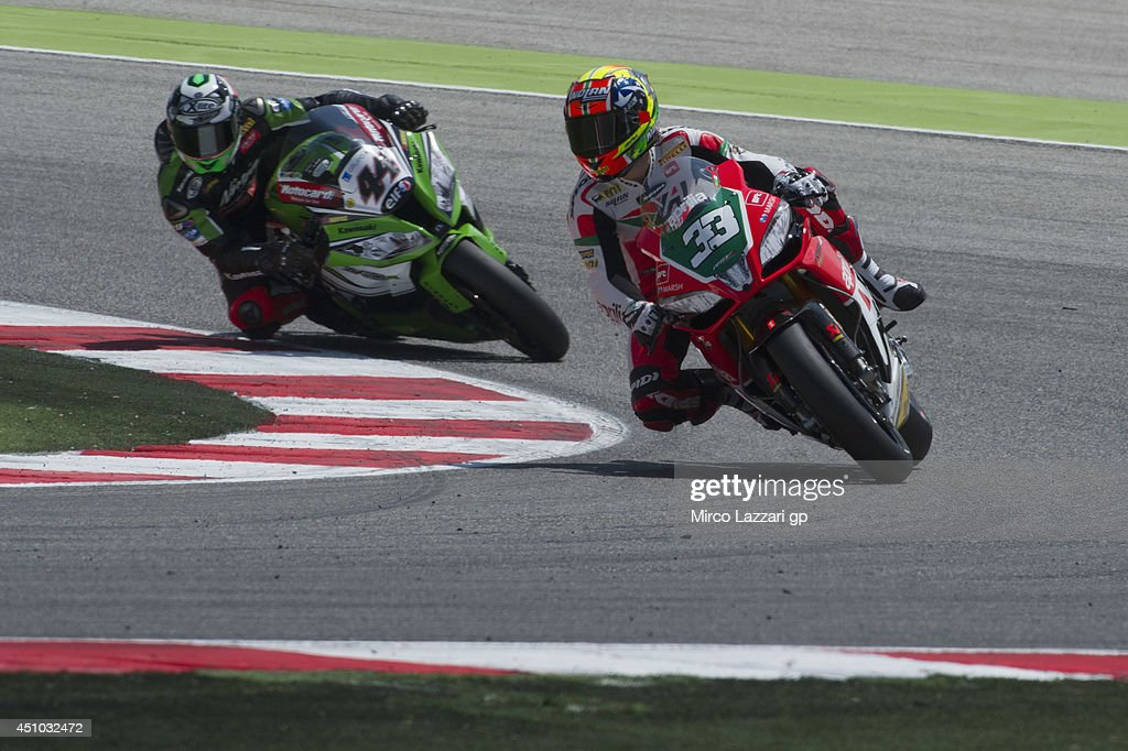 <a gi-track='captionPersonalityLinkClicked' href=/galleries/search?phrase=Marco+Melandri&family=editorial&specificpeople=204382 ng-click='$event.stopPropagation()'>Marco Melandri</a> of Italy and Aprilia Racing Team leads David Salom of Spain and Kawasaki Racing Team during the Superbike race 2 during the FIM Superbike World Championship - Race at Misano World Circuit on June 22, 2014 in Misano Adriatico, Italy.