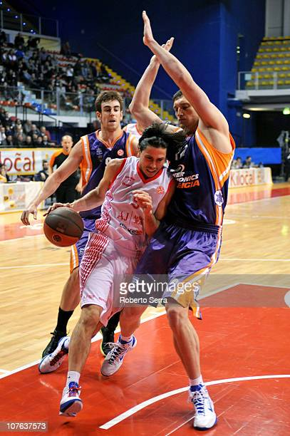 Marco Mordente of Armani Jeans competes with Serhiy Lishchuk of Power Electronics during the 20102011 Turkish Airlines Euroleague Regular Season Date...